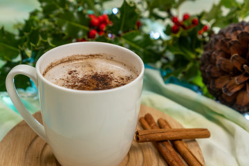 Mug of Christmas flavored hot chocolate in a merry festive background. Winter Holidays indoors.