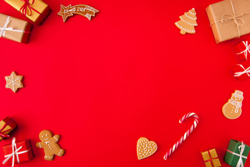 Invitation x-mas card idea. High angle view photo of baked newyear elements figures holiday composition with empty space in middle made isolated on bright red background