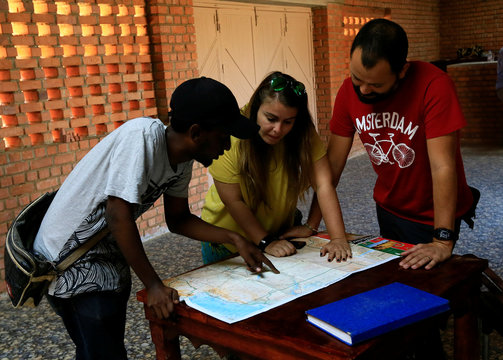 Tourists look at site map inside the site information centre of the Royal Cemeteries of Meroe Pyramids in Begrawiya at River Nile State