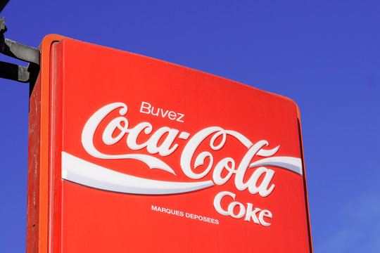 Coca Cola advertisement sign logo coffee store cafe famous carbonated soft refreshment drink bar wall