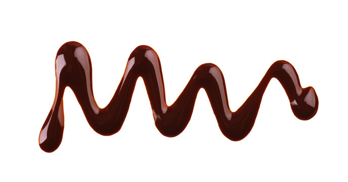 Chocolate syrup drizzle isolated on white background. Splashes of sweet chocolate sauce. Top view.