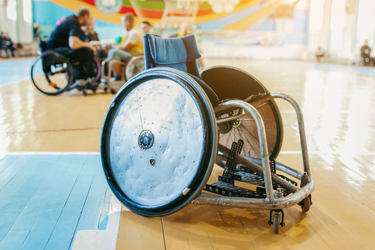 Modified wheelchair for play in rugby