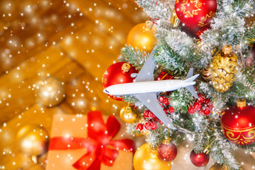 Wall Mural - Christmas background with airplane. Travel concept for the holidays. Selective focus.