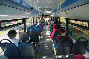 The interior of the public bus traveling to Maspalomas, the passengers are calm and patient. Touristic and travelling concepts.