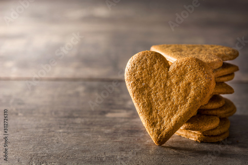 Heart shaped cookie on wooden table with copy space. Valentine's Day and Mother's Day concept.