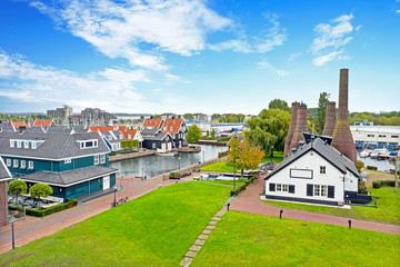 Aerial from traditional brick factory and houses in Huizen the Netherlands