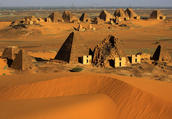 Creeping desert sands surround the Royal Cemeteries of Meroe Pyramids in Begrawiya at River Nile State