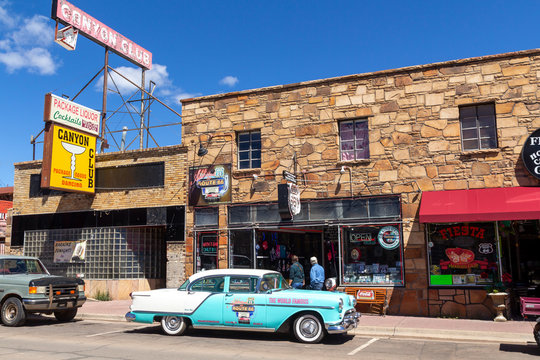 Williams, Arizona, USA: May 24, 2019: Street scene with classic car in front of souvenir shops in Williams, one of the cities on the famous route 66