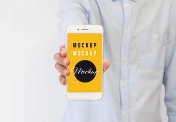 Hand Holding a Smartphone Mockup