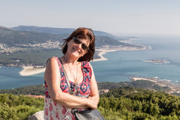 Portrait of woman on her vacation in Galicia, Spain