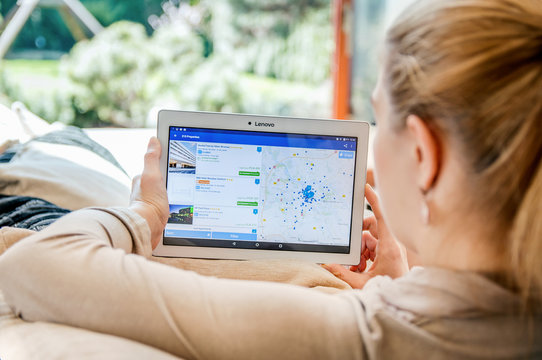 WROCLAW, POLAND- APRIL 10th, 2017:  Woman launches booking.com application on Lenovo tablet. Booking.com is a travel fare aggregator website and travel metasearch engine for lodging reservations