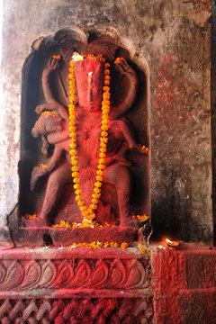 Hayagriva, horse-headed incarnation of Hindu Lord Vishnu, with garland and red powder, Hayagriva Madhava Temple, Hajo, Assam