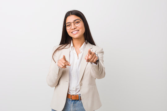 Young business arab woman isolated against a white background cheerful smiles pointing to front.