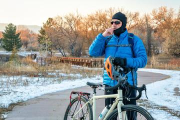putting balaclava and helmet on for winter biking