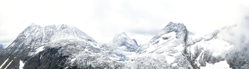 Aerial panoramic of Store Venjetinden and Olaskarstinden mountains covered with snow, Venjesdalen valley, Romsdalen, Rauma, Norway, Scandinavia, Europe