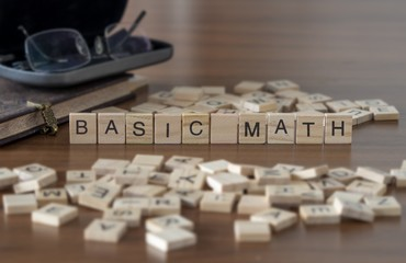 The concept of Basic Math represented by wooden letter tiles