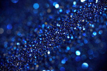 Imitation of the galaxy in endless space. Abstraction. Blue sparkling background with shallow depth of field. Magic and fiction