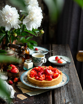 Homemade delicious strawberry tart or pie with sweet glazed berries on top