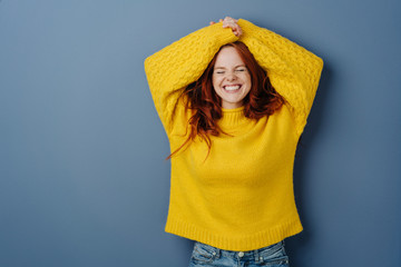 Cute charismatic young woman grinning happily