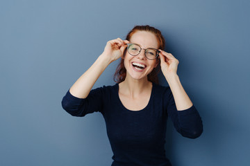 Cute laughing young woman wearing spectacles