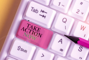 Conceptual hand writing showing Take Action Now. Concept meaning asking someone to start doing Good perforanalysisce Encourage White pc keyboard with note paper above the white background