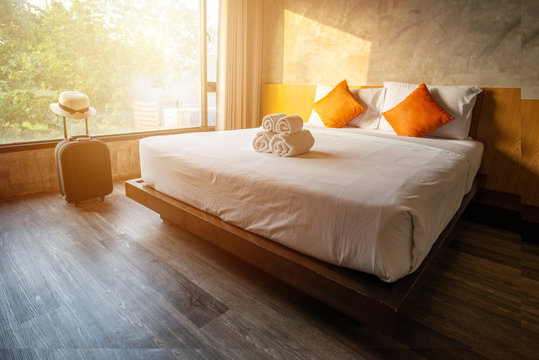 The comfortable hotel bedroom in cozy style.
