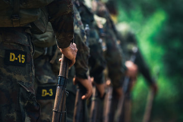 Soldiers stand in row. Gun in hand. Army, Military Boots lines of commando soldiers in camouflage uniforms Thailand