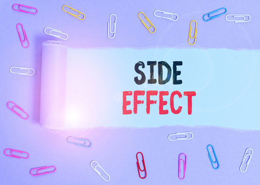 Conceptual hand writing showing Side Effect. Concept meaning typically undesirable effect of a drug or medical treatment Paper clip and torn cardboard on wood classic table backdrop
