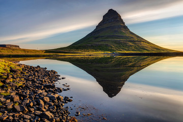 A perfect Kirkjufell Reflection in West Iceland with interesting clouds