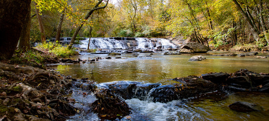 Fototapeta Waterfall and stream with rocks--wide angle obraz