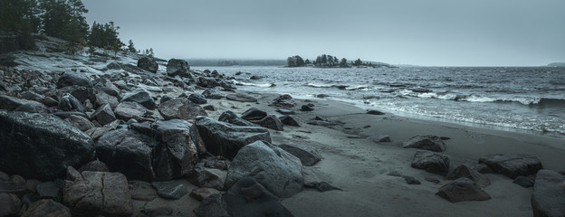 Panorama of a rocky shore. Overcast day. Background for travel materials Fotobehang