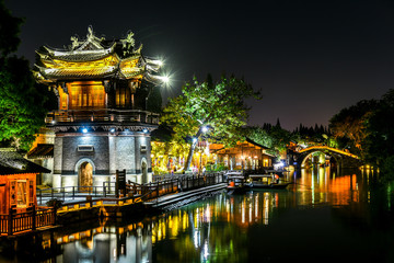 Night view of The famous and Beautiful water town scenery of West Gate Wuzhen town ancient is a historical and cultural town in Zhejiang CHINA.