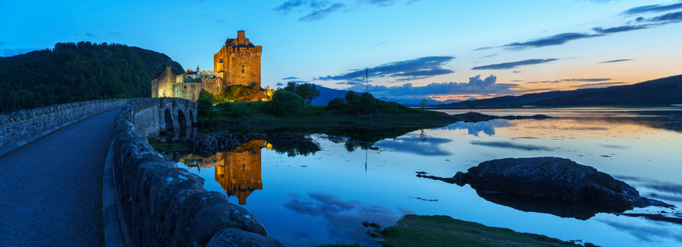 Eilean Donan Castle is one of the most important attractions in the Scottish highlands , at the point where three great sea-lochs meet in sunset with reflection,  Kyle of Lochalsh , Scotland