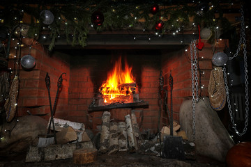 decorated christmas fireplace at night