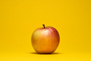 organic apple on a yellow background