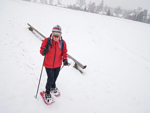 Single snow walker or cross skier sports woman and gray clouds i
