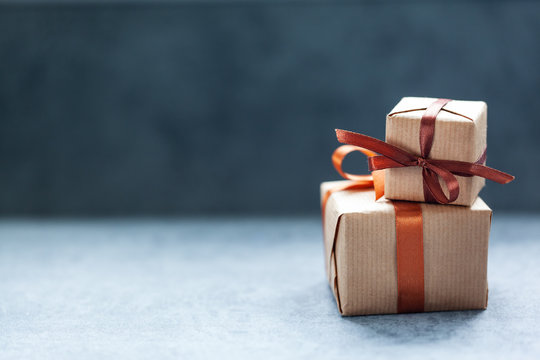 Holidays present boxes with brown ribbon on dark background