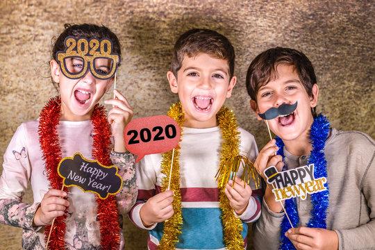 Three kids celebrating New Years Eve. 2020!
