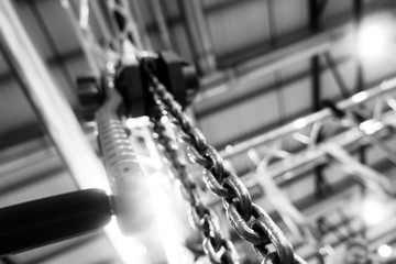 Lever winch. Tal lever. Manual chain hoist. Shallow depth of field. Focus on Chain Link