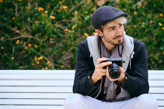 Portrait Of Hipster Street Photographer Holding Mirrorless Camera