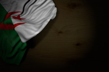 nice dark picture of Algeria flag with large folds on dark wood with free place for your content - any occasion flag 3d illustration..