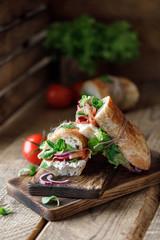 Poster Picnic Fresh sandwich with tomatoes, jamon, corn salad and philadelphia cheese