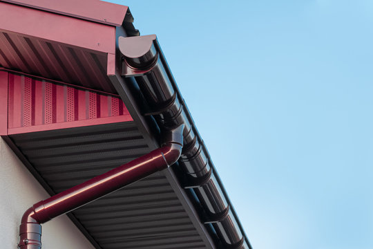 Plastic roof gutter and drain pipe with copy space