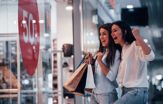 Feeling excited. Two young women have a shopping day together in the supermarket