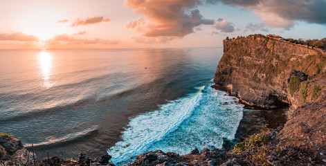Beautiful Panoramic view of an Iconic Famous Place, Uluwatu Temple, during a vibrant summer...