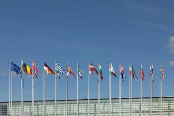 All EU Flags European Union flag waving in front of European Parliament, headquarter of the European Commission European Parliament