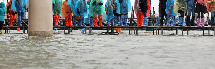 footbridge on the water during the flood in Venice in Italy