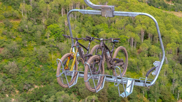 Panorama Close up of chairlifts with mountain bikes in Park City ski resort at off season