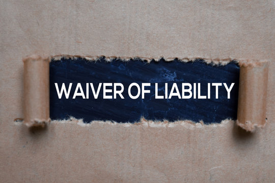 Waiver Of Liability Text written in torn paper