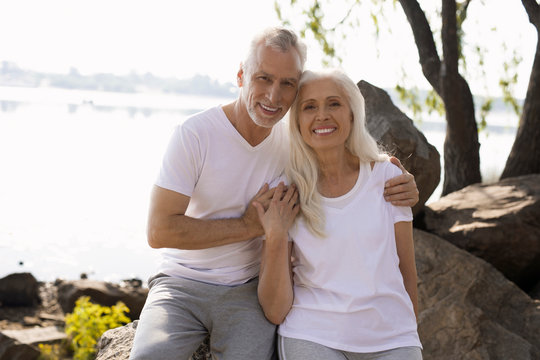 Delighted man and woman on the rocks stock photo